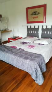 Un ou plusieurs lits dans un hébergement de l'établissement La Chambre du Meunier