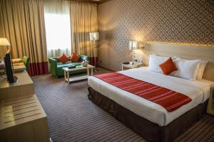 A bed or beds in a room at Saffron Boutique Hotel