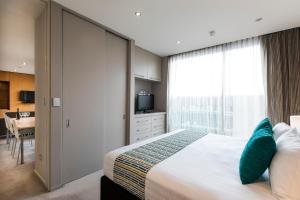 A bed or beds in a room at Quest Carlaw Park Serviced Apartments