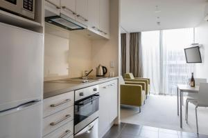 A kitchen or kitchenette at Quest Carlaw Park Serviced Apartments