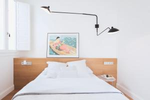 A bed or beds in a room at La Rotativa