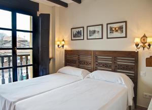 Cama o camas de una habitación en Hotel The Island