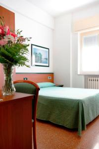 A bed or beds in a room at Albergo Adriana
