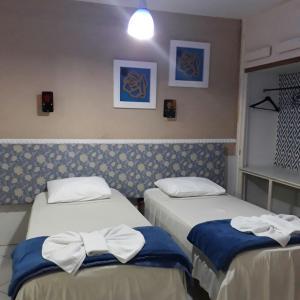 Cama ou camas em um quarto em Pousada Convento Da Penha