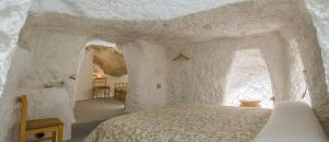 A bed or beds in a room at Casa Cueva Las Tinajas de Naya