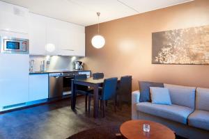 A kitchen or kitchenette at Spa Hotel Peurunka