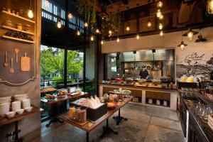 A restaurant or other place to eat at Somerset Ekamai Bangkok