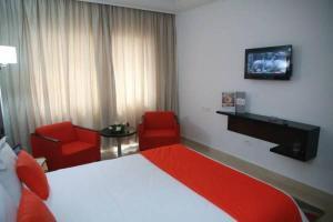 سرير أو أسرّة في غرفة في فندق الباشا