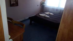 Ein Bett oder Betten in einem Zimmer der Unterkunft Garni Hotel Anne-Mary