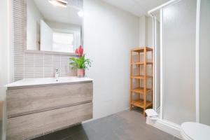 Ett badrum på Apartamentos Salamanca
