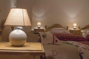 Un ou plusieurs lits dans un hébergement de l'établissement gite les rochettes