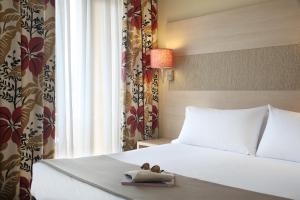 Кровать или кровати в номере Augusta Club & Spa - Adults Only