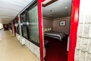 A bunk bed or bunk beds in a room at New Plaza Motel