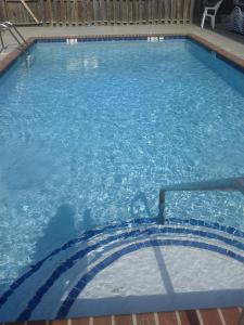 The swimming pool at or near Baymont by Wyndham Cartersville
