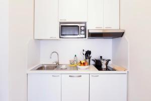 A kitchen or kitchenette at Aparthotel Adagio Rome Vatican