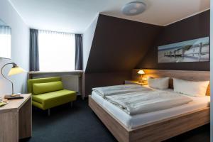 Ein Bett oder Betten in einem Zimmer der Unterkunft Pension Alabama