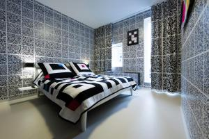 A bed or beds in a room at Design Hotel Modez
