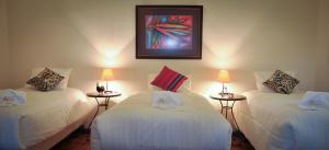 Cama o camas de una habitación en Anami Hotel Boutique