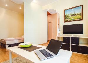 Телевизор и/или развлекательный центр в Miracle Apartments Арбатская