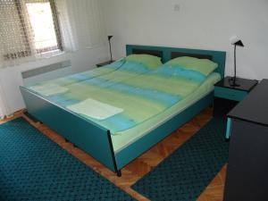 Кровать или кровати в номере Apartments Marjan