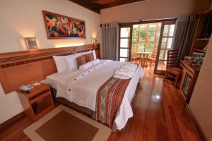 Un ou plusieurs lits dans un hébergement de l'établissement Casa del Sol Machupicchu