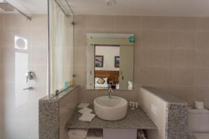 A bathroom at Oasis Kathmandu Hotel