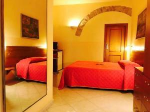 Ein Bett oder Betten in einem Zimmer der Unterkunft Corato room economy