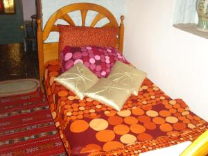 A bed or beds in a room at Dar Nouzha A