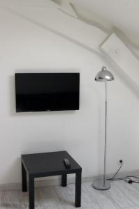 A television and/or entertainment center at Beau Studio Nice