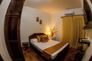 Cama ou camas em um quarto em Pousada Casarão