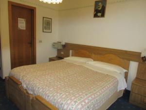 Кровать или кровати в номере Garnì Defrancesco