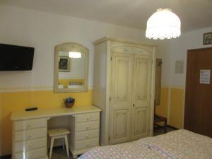 Телевизор и/или развлекательный центр в Garnì Defrancesco