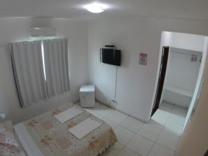 A television and/or entertainment center at Cantinho da Melão