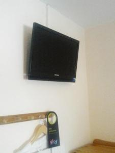 A television and/or entertainment centre at Heidi's ART