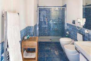 A bathroom at Grifo Hotel Charme & SPA
