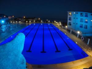 The swimming pool at or near Hotel Brancamaria con minicrociera nel Golfo