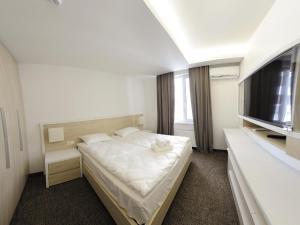 Lova arba lovos apgyvendinimo įstaigoje Apartment OneClickRent 2 SmartHouse