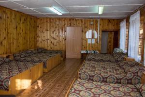 Кровать или кровати в номере Гостиница Молодёжная