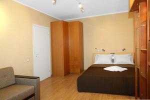 Кровать или кровати в номере Apartment on Krylatskoe