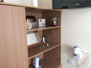 A television and/or entertainment center at Rudan Guest House