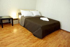 Кровать или кровати в номере Apartment on Elninskay 18