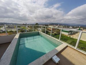 The swimming pool at or near Tri Hotel São João Batista
