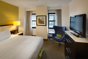 A television and/or entertainment center at The Hollis Halifax - a DoubleTree Suites by Hilton