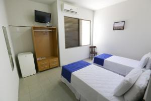 Cama ou camas em um quarto em Hotel Porto do Sol