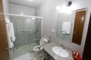 Um banheiro em Hotel Porto do Sol