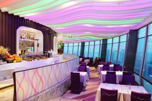 A restaurant or other place to eat at Asia International Hotel Guangdong