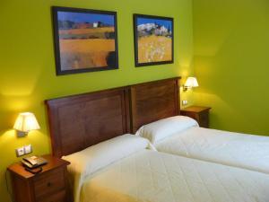 A bed or beds in a room at Ciudad del Renacimiento