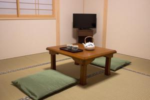 A television and/or entertainment center at Kamoya Ryokan