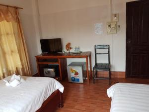A bed or beds in a room at Maylay Guesthouse