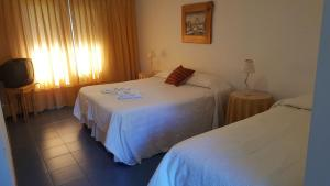 A bed or beds in a room at Hosteria Tres Picos